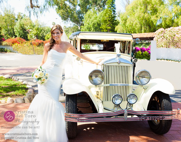 Bride Poses on Antique Car
