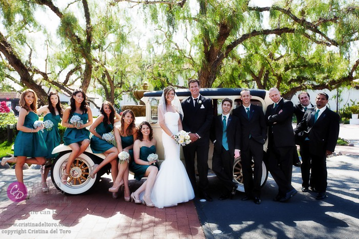 Bridal Party Poses with Antique Car