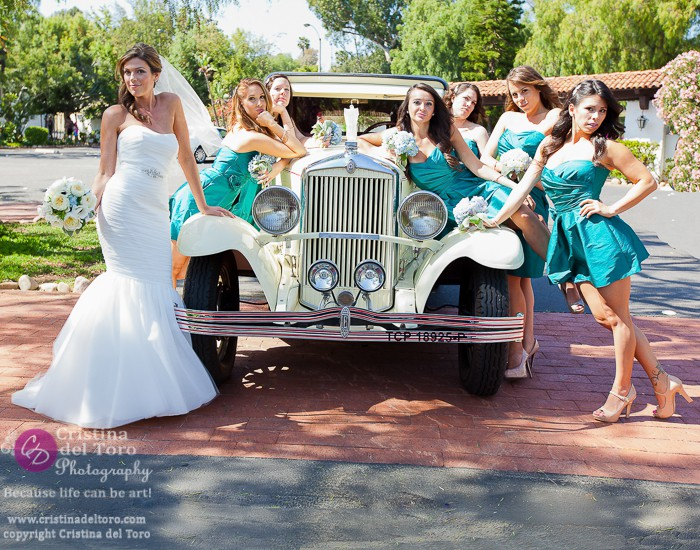 Bride and bridesmaids pose with Antique Car