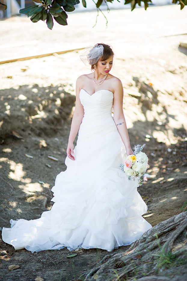 bride with white dress and flowers