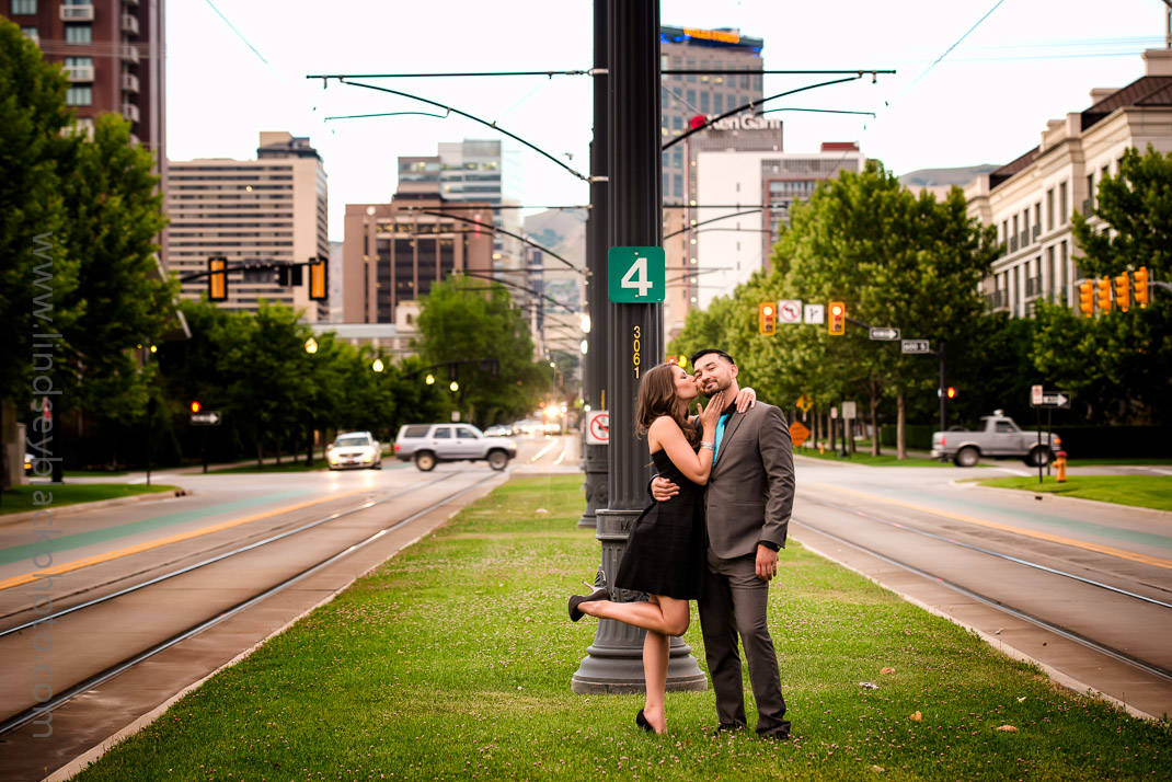 Utah Wedding Photographer | Lindsey Black | Downtown Salt Lake Engagements with the bride kissing the groom's cheek