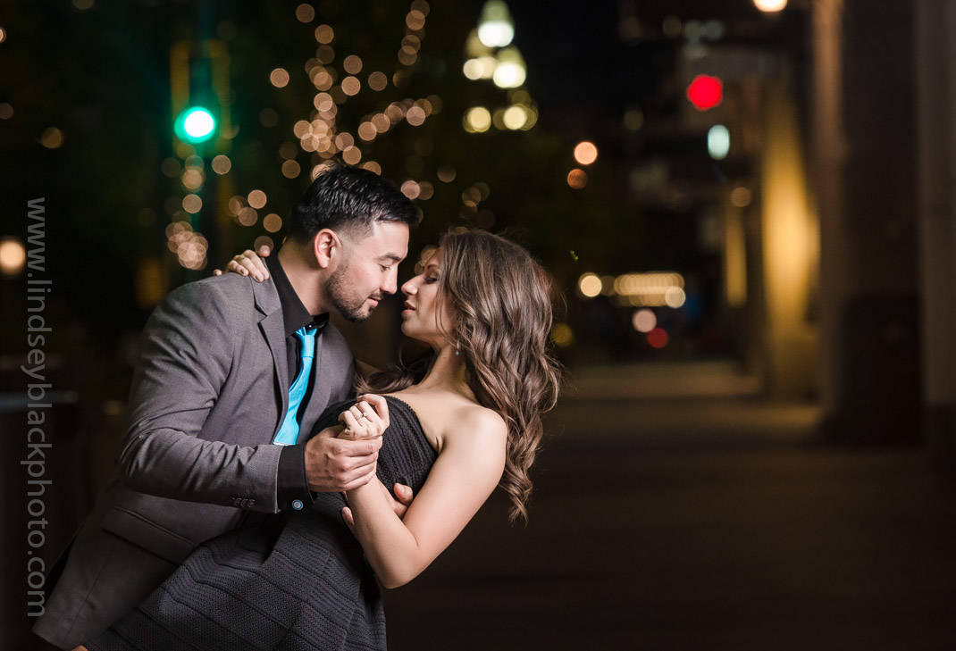 Utah Wedding Photographer | Lindsey Black | Downtown Salt Lake Engagements at night with the couple dancing