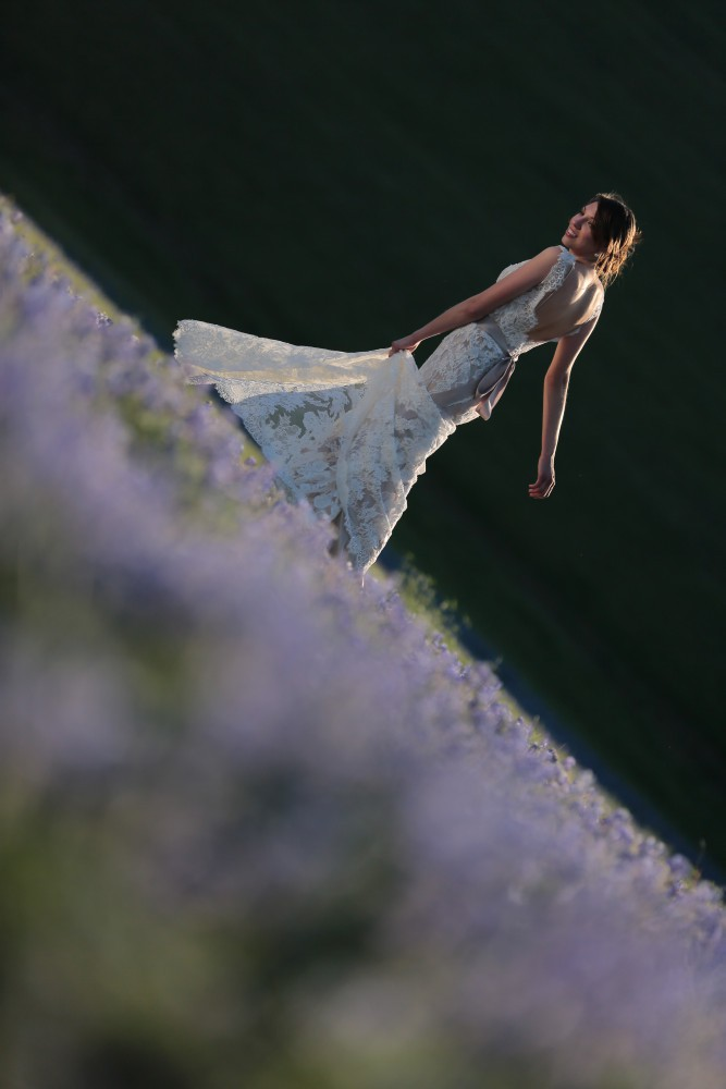 bride dancing in field of blue bonnet flowers