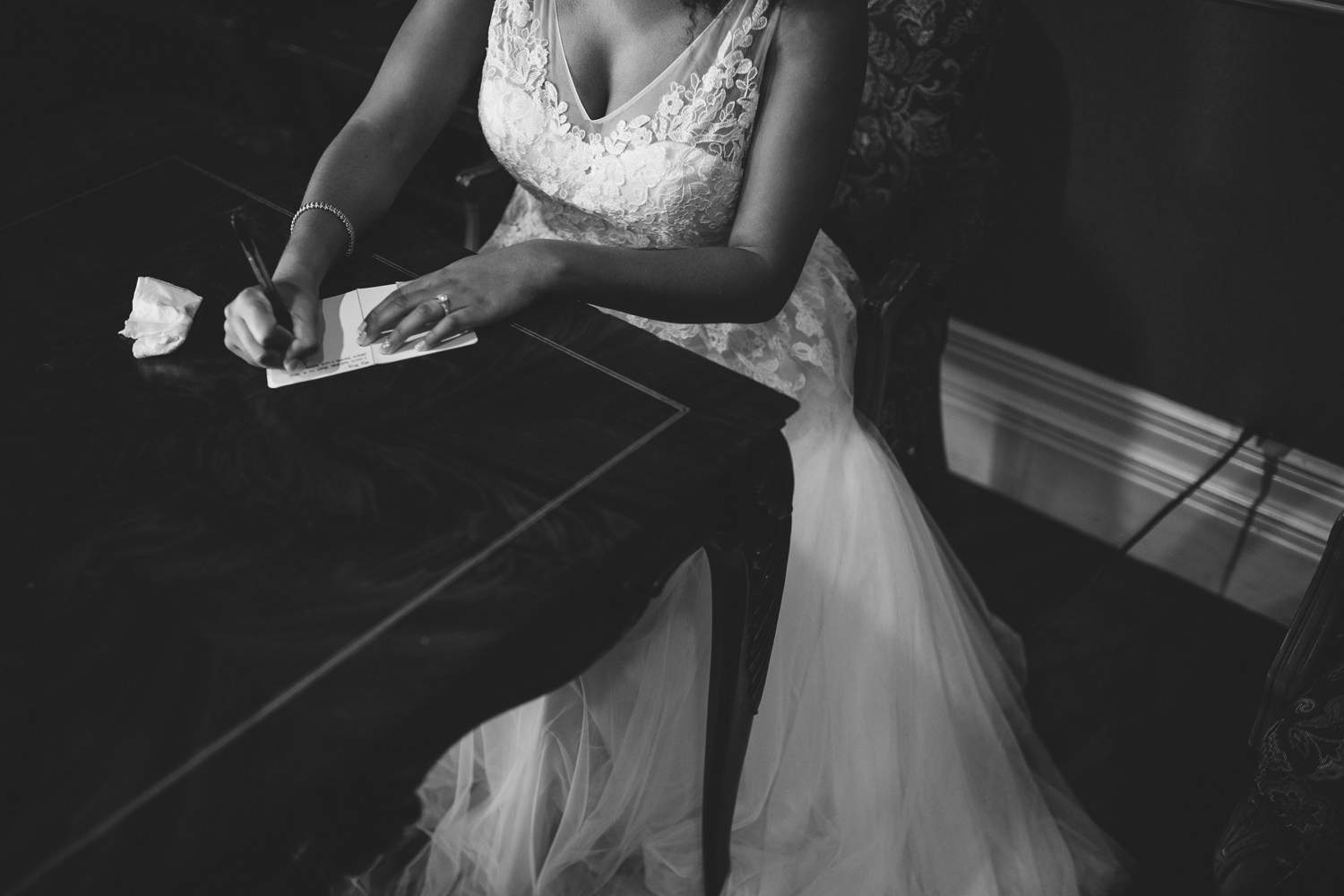 black and white portrait of BHLDN bride writing vows