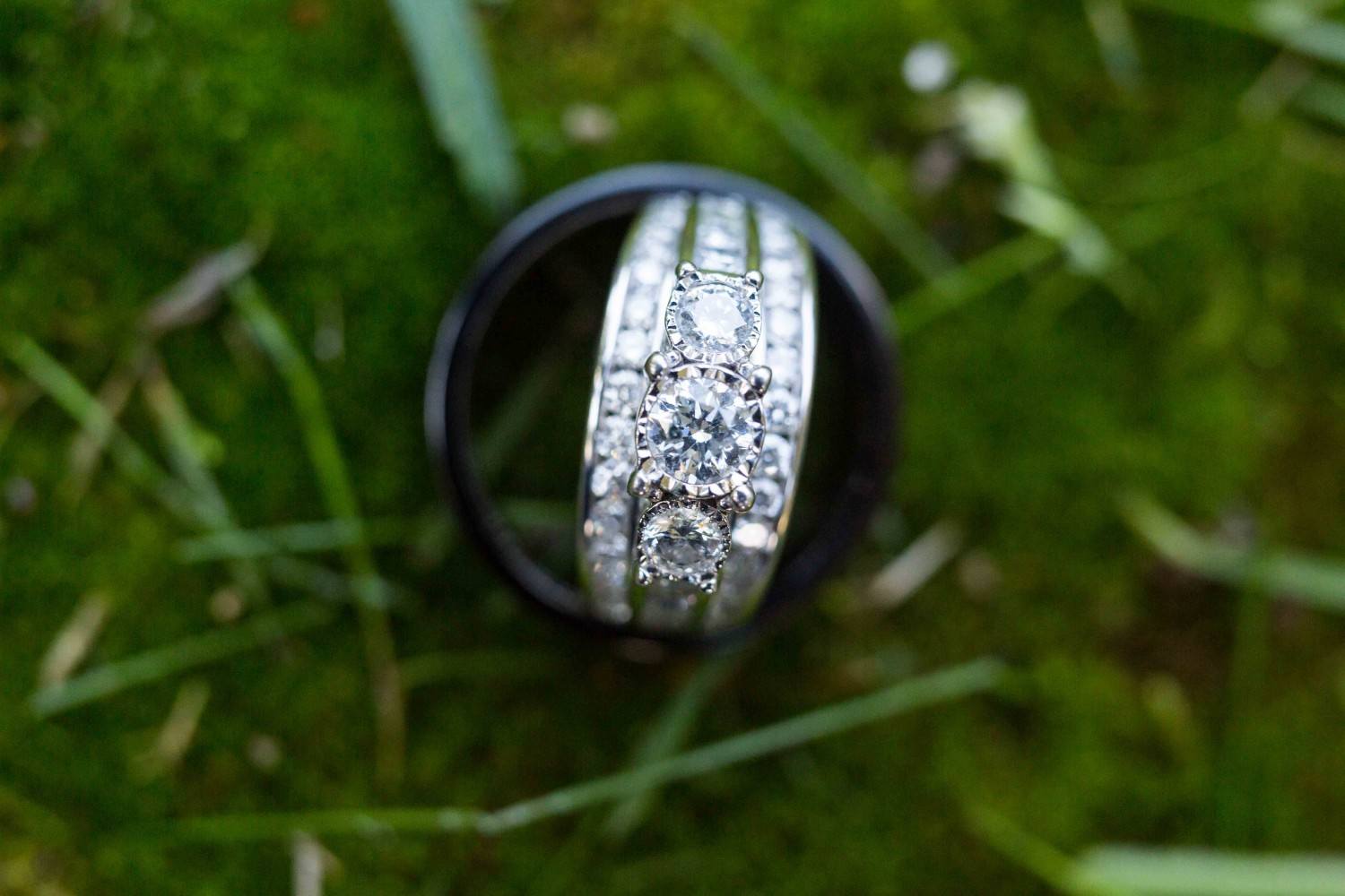 Bride and groom's ring on moss. Stunning wedding photography from Spokane.