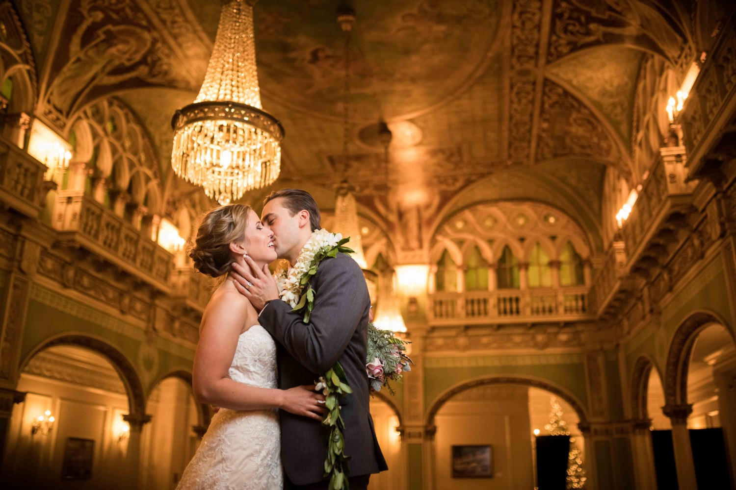 Spokane Davenport wedding inside a ballroom with bride and groom kissing