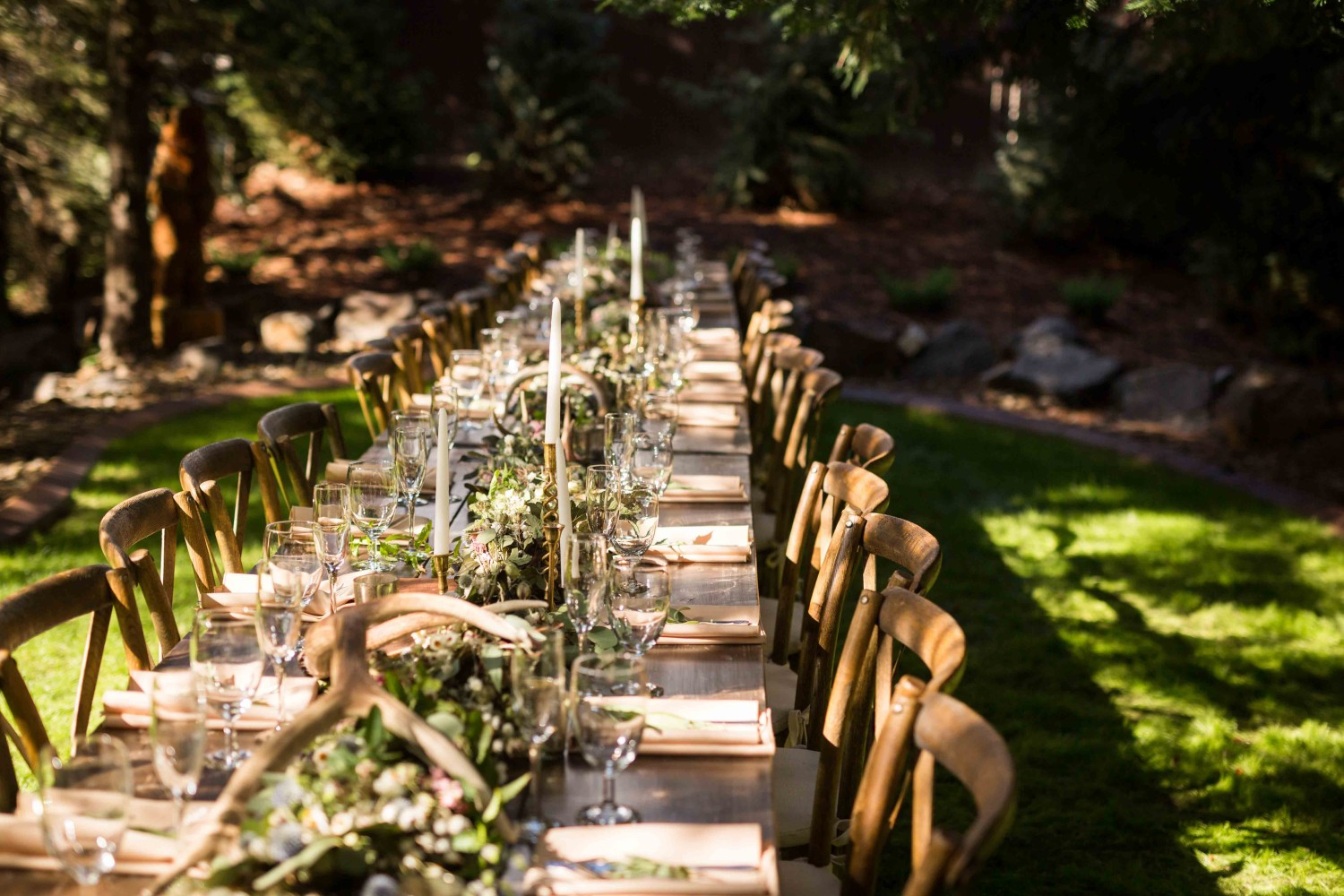 Backyard DIY wedding table setup with antlers, candles and more.