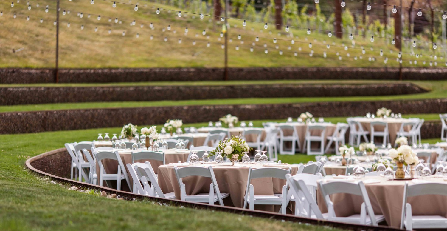 Tables and chairs with the centerpieces at Settlers Creek Coeur d'Alene Wedding Venue