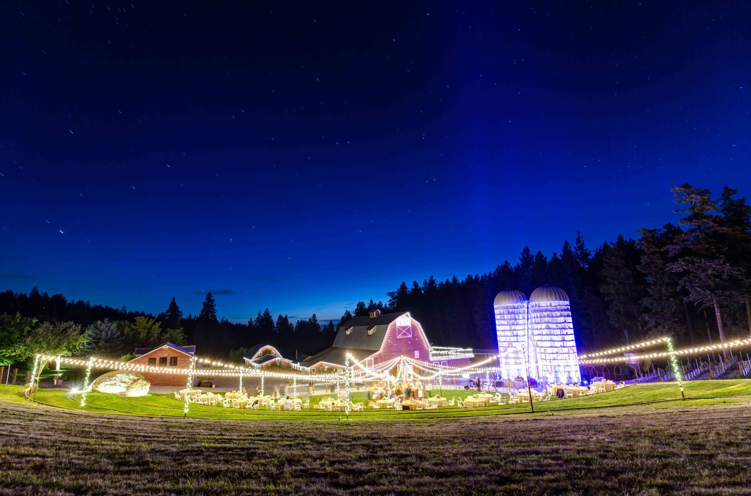 Wide shot of Settlers Creek at night, the Coeur d'Alene wedding Venue