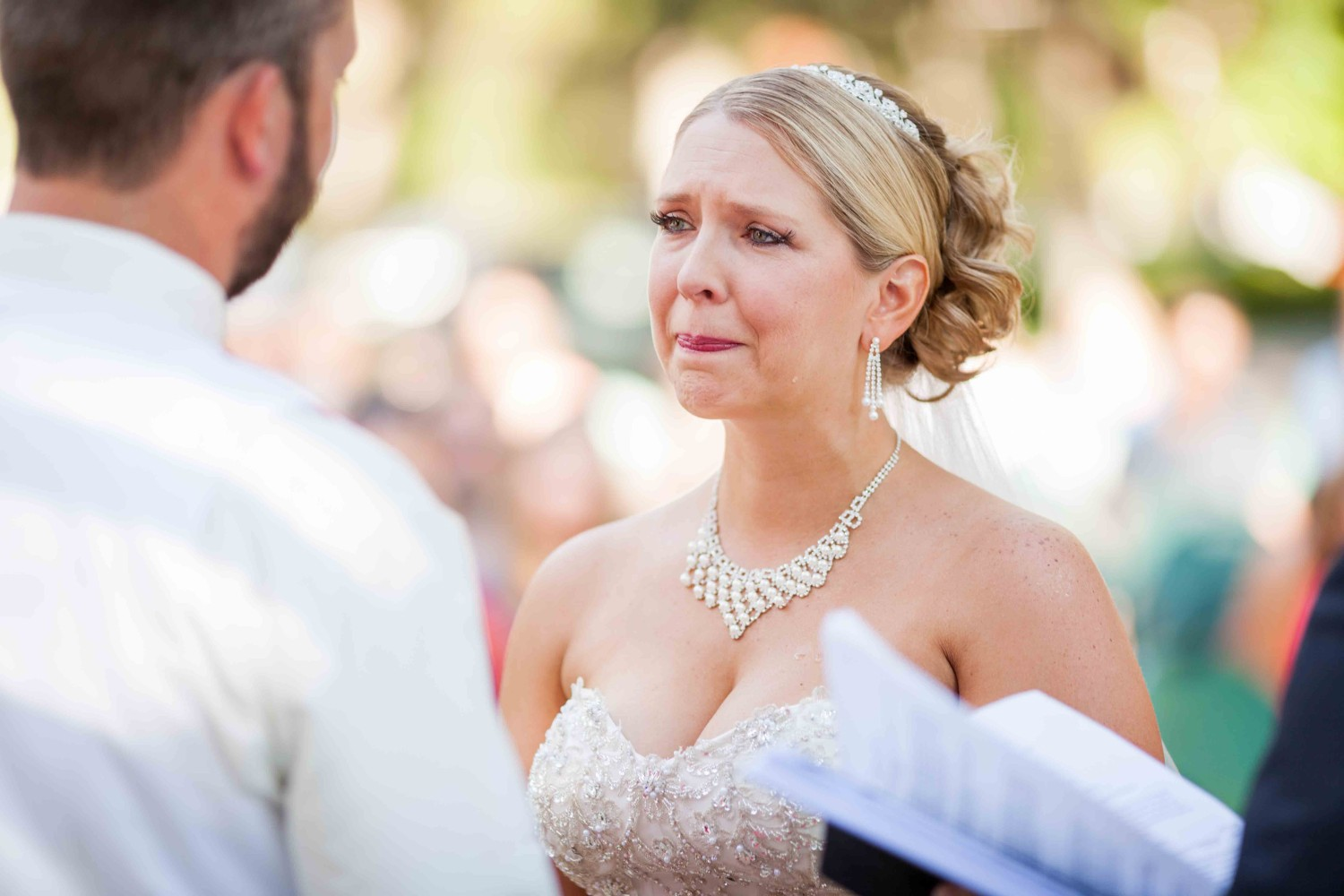 Bride crying during their wedding ceremony vows.