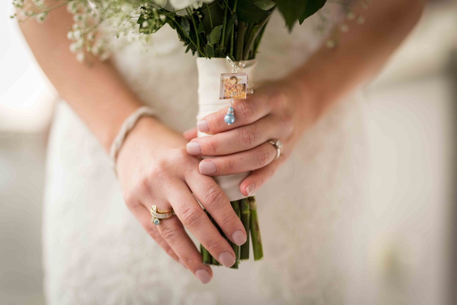 Brides bouquet with rings and details of brides hands