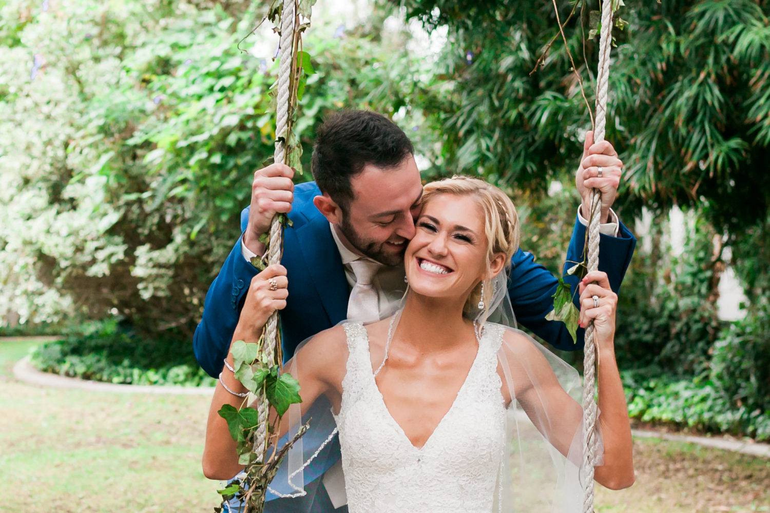 Bride and Groom on a Swing shot by Orange County wedding photographer Brad Rauch