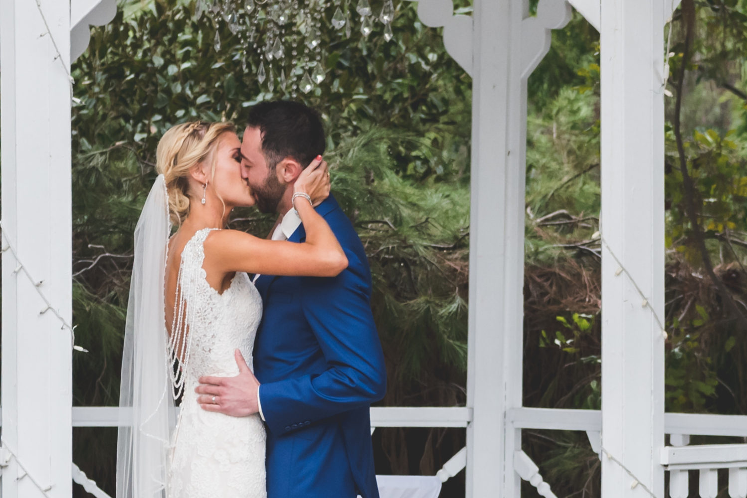 Orange County bride and groom first kiss by wedding photographer Brad Rauch