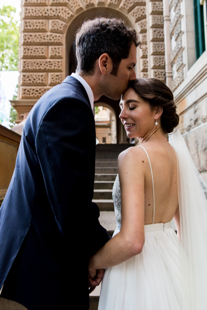 The newly married couple take a moment on the stairs of Sydney's Intercontinental hotel
