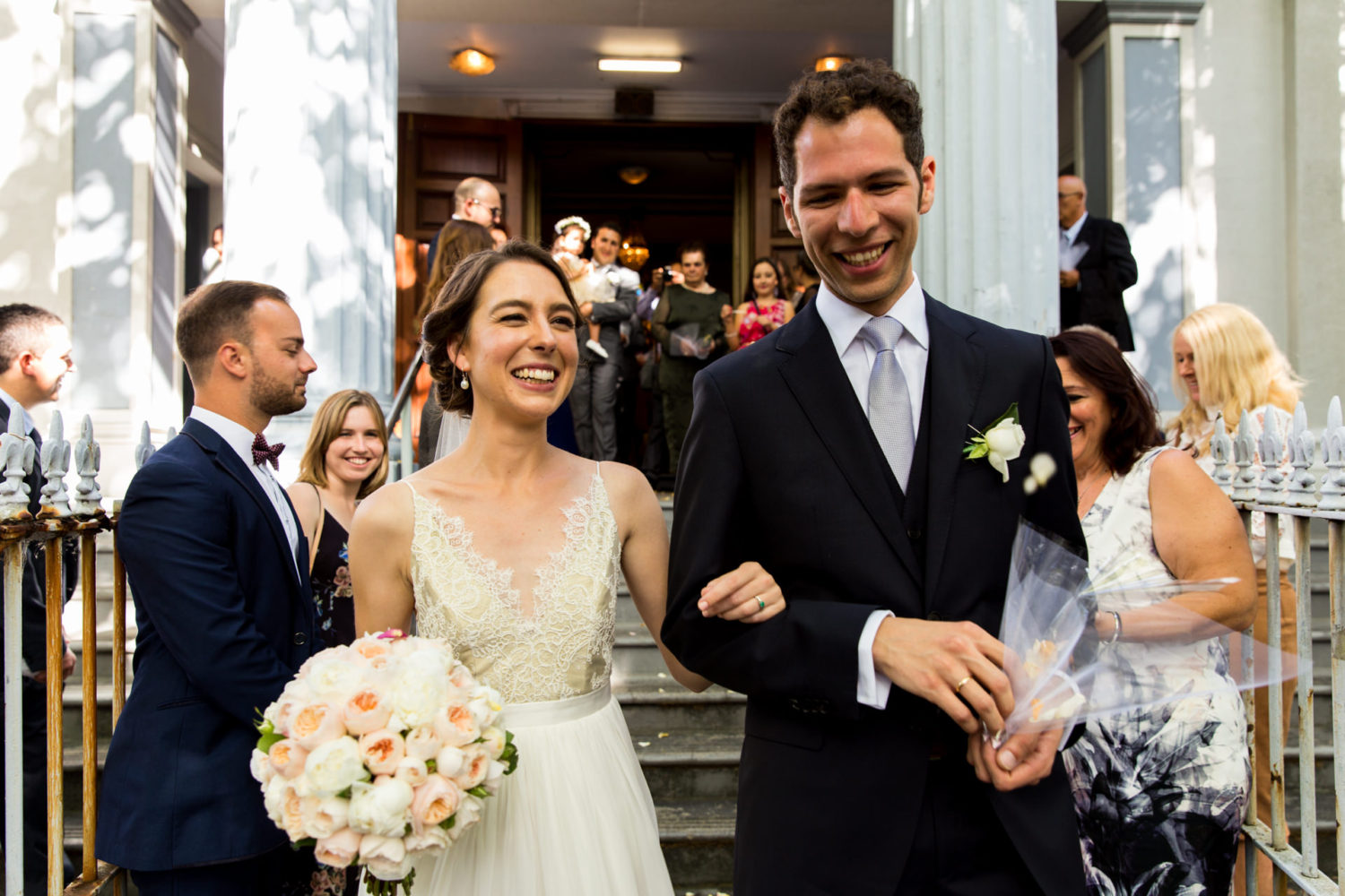 Just married couple exit the church in Sydney after their Greek wedding ceremony