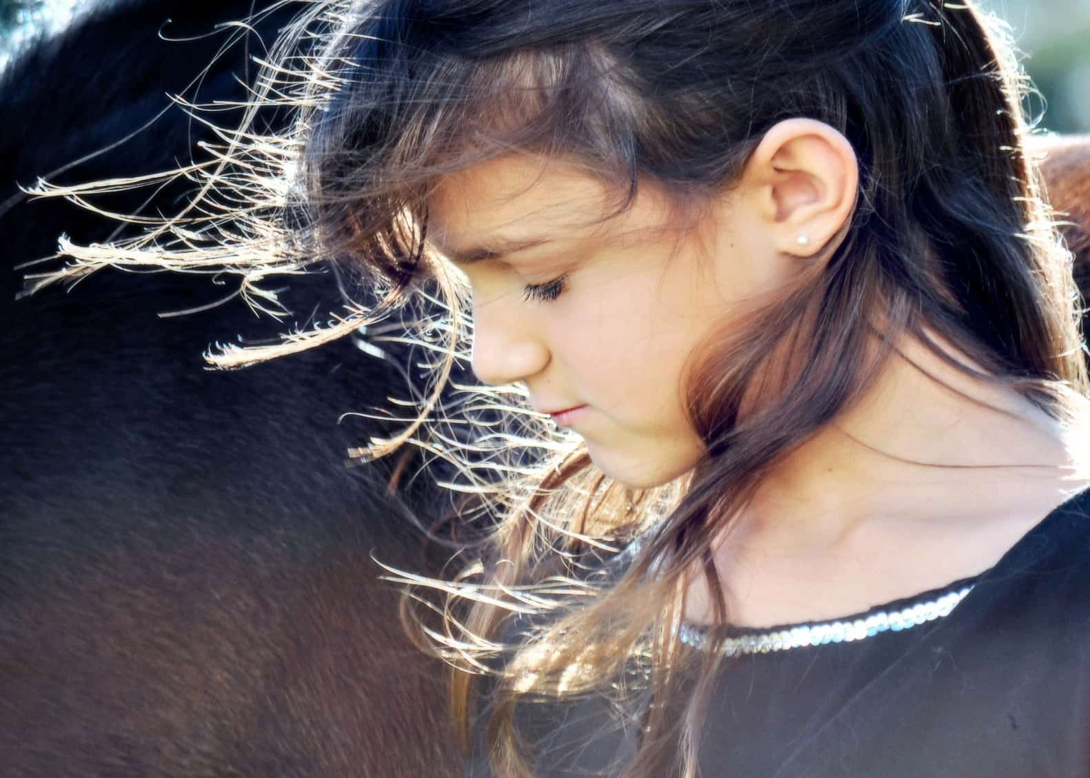 Color photo of young girl with her hair flowing in the sunlight
