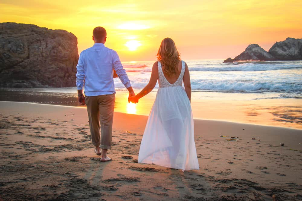 Couple Walking Towards Sunset Sutro Baths Engagement Photo