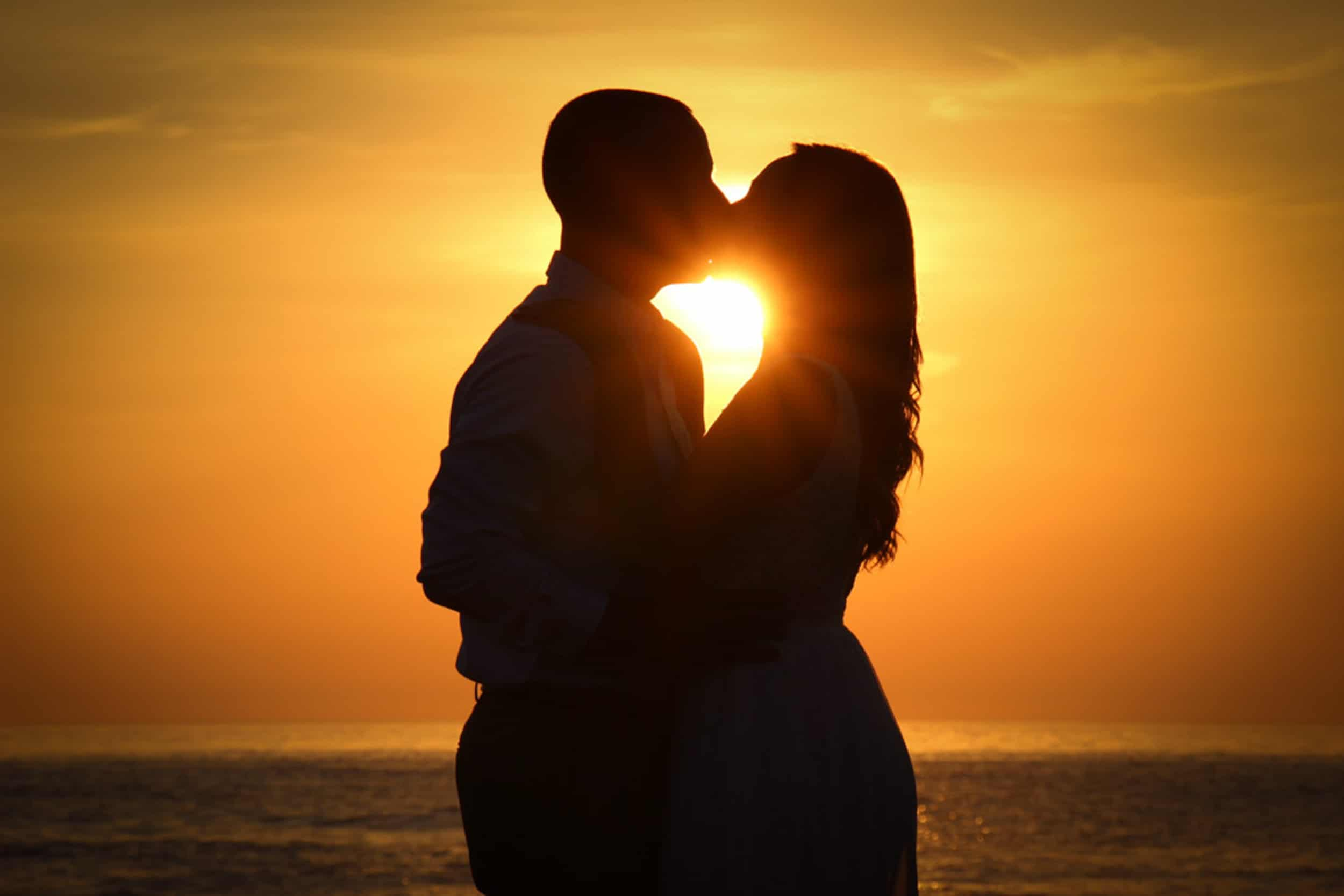 kiss at sunset on the beach