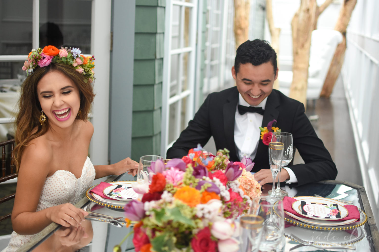 Bride and Groom Sitting at Table - © Jade Elora Photography