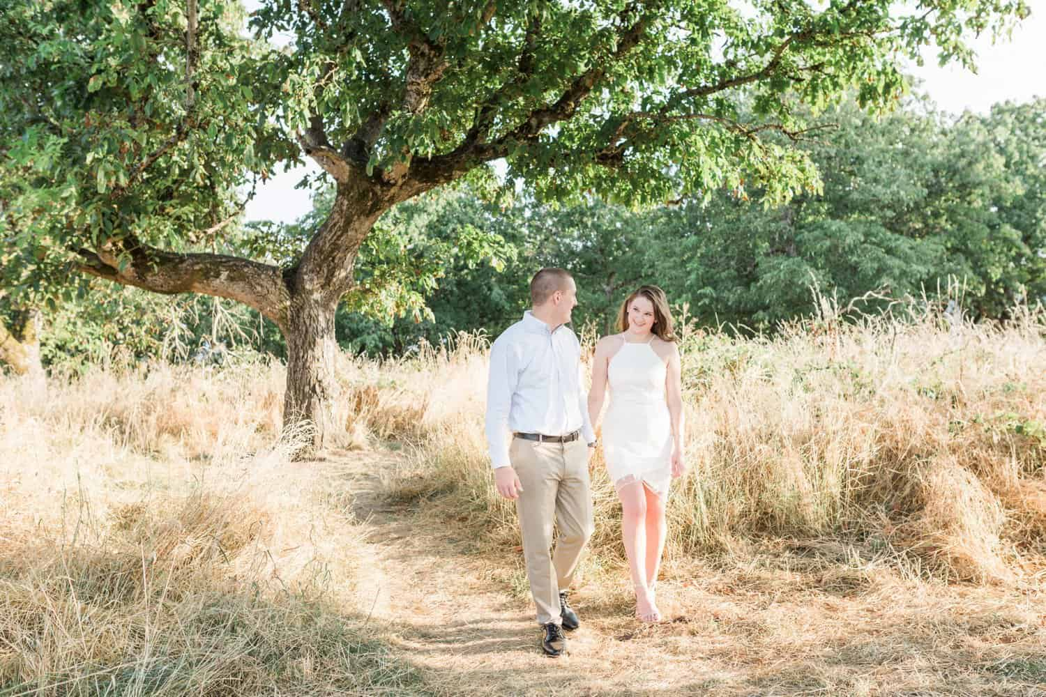 Oregon Wedding Photographer takes candid outdoor engagement photos.