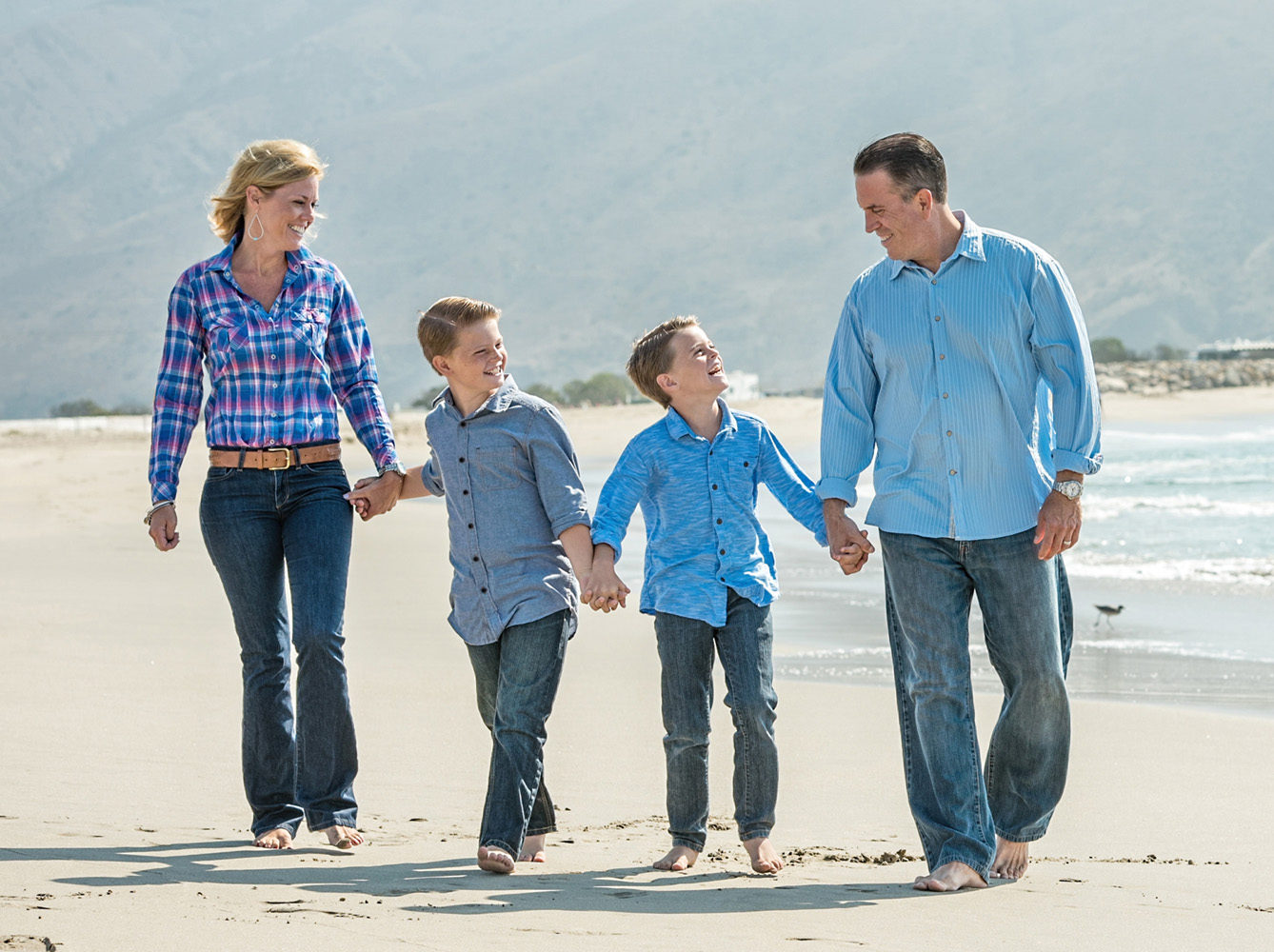 family holding hands walking on sand by Camarillo photographer Toki Lee