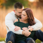 Engaged Couple Embracing in Fall Colors