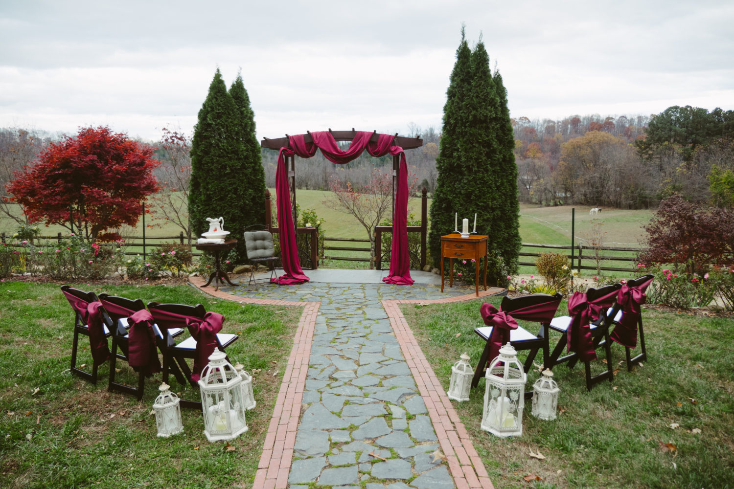 a memorable micro wedding with elegant burgundy draping