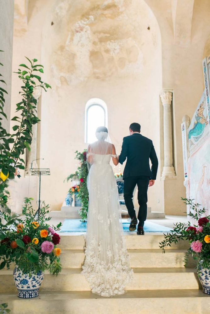 bride-and-groom-at-altar-ancient church-italy