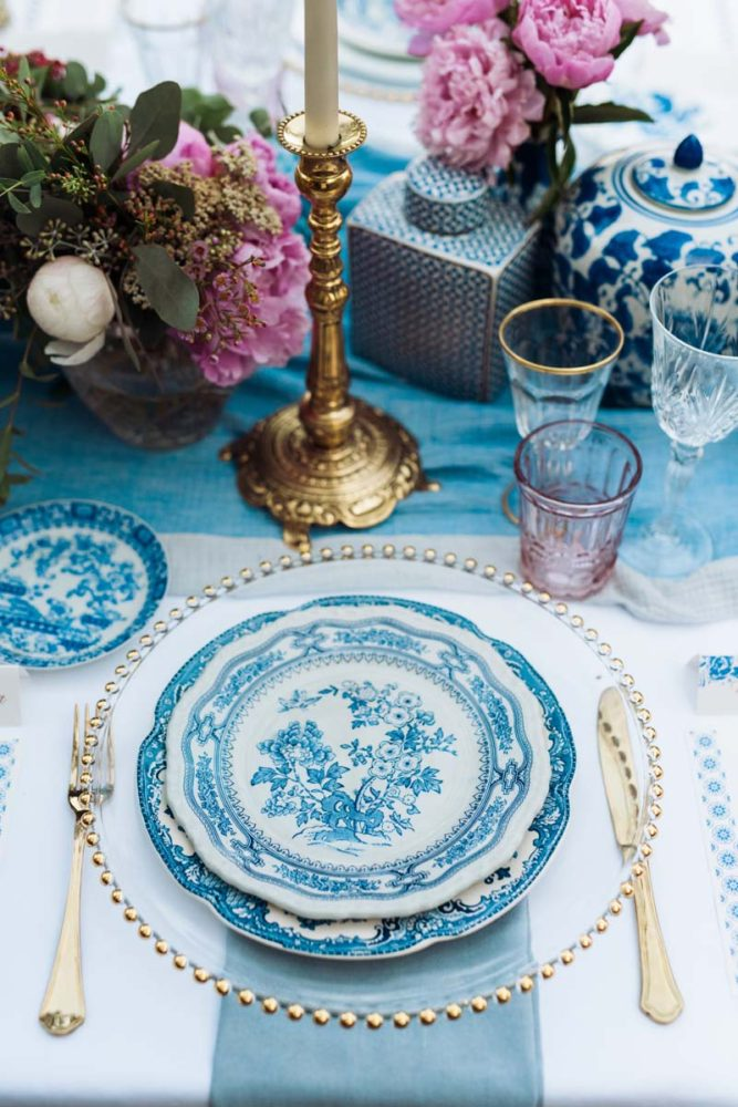 wedding-dinner-table-place-setting-boho-chic-long-tables-mixed-glassware-gold-candlesticks-vintage-chinese-blue-and-white-plates
