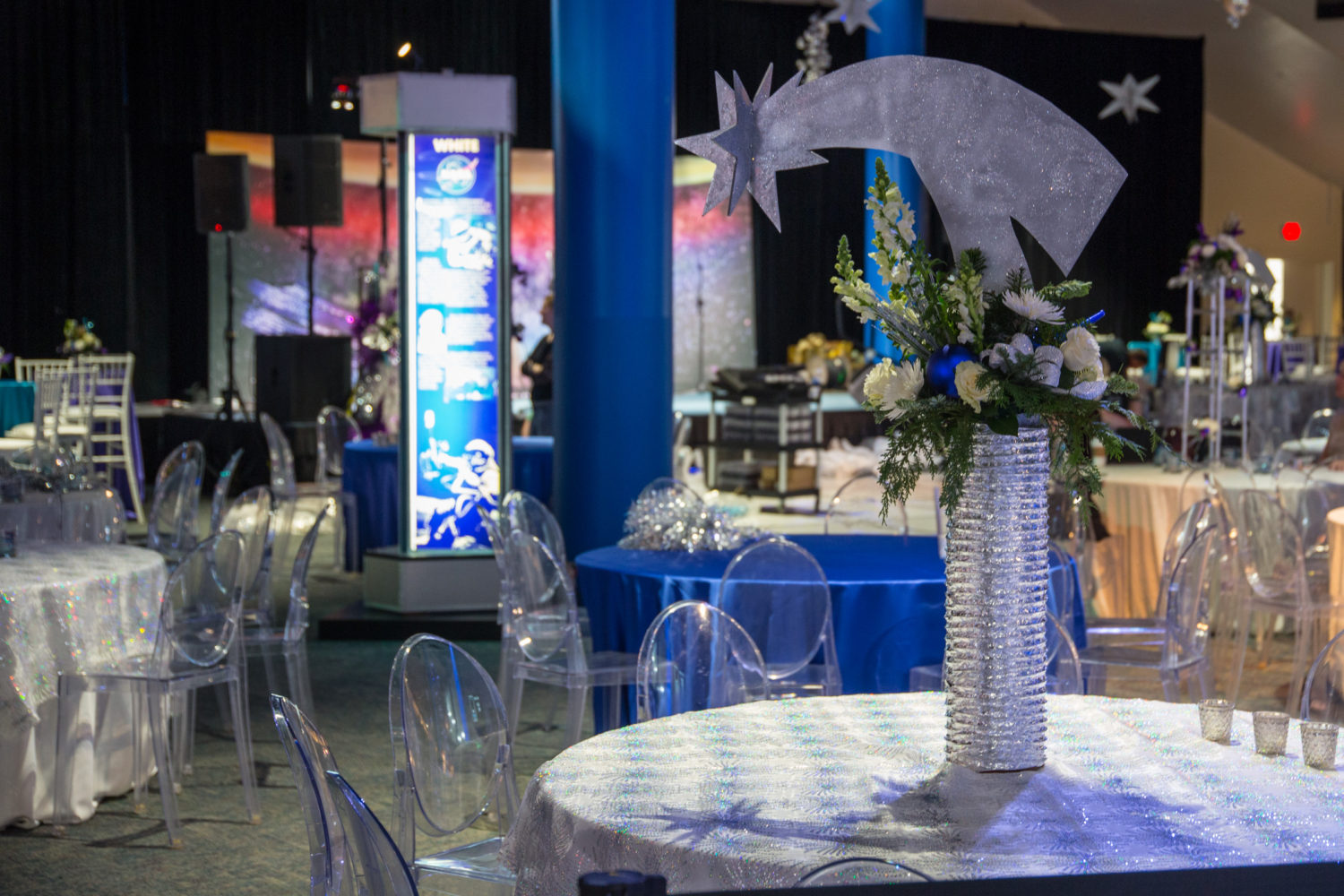 Beautiful tables and space-themed center pieces